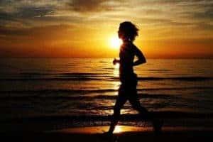 woman runs by the sea