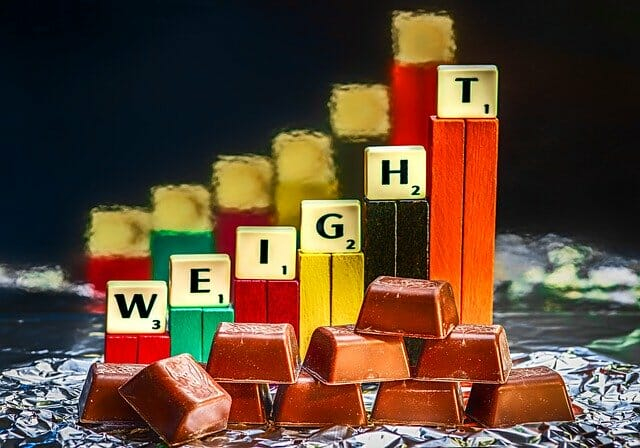 体重増加を示すチョコレートバーとバー
